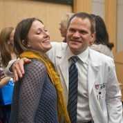 Brigham & Women's Hospital Dr. Eric Halvorson hugs Marathon survivor, Nicole Gross.