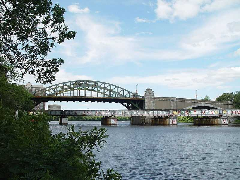 The Boston University Bridge on Commonwealth Avenue is one of the only places in the world where a boat can sail under a trainpassing under a car driving under an airplane.