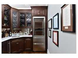 Agracious butler's pantry/bar.