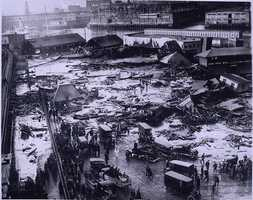 On January 15, 1919, the Boston Molasses Disaster occurred in the North End. Twenty-one people were killed and another 150 injured as hot molasses crushed, asphyxiated, and cooked many of the victims to death. It took over six months to remove the molasses from the cobblestone streets, theaters, businesses, automobiles, and homes. Boston Harbor ran brownthrough thesummer.