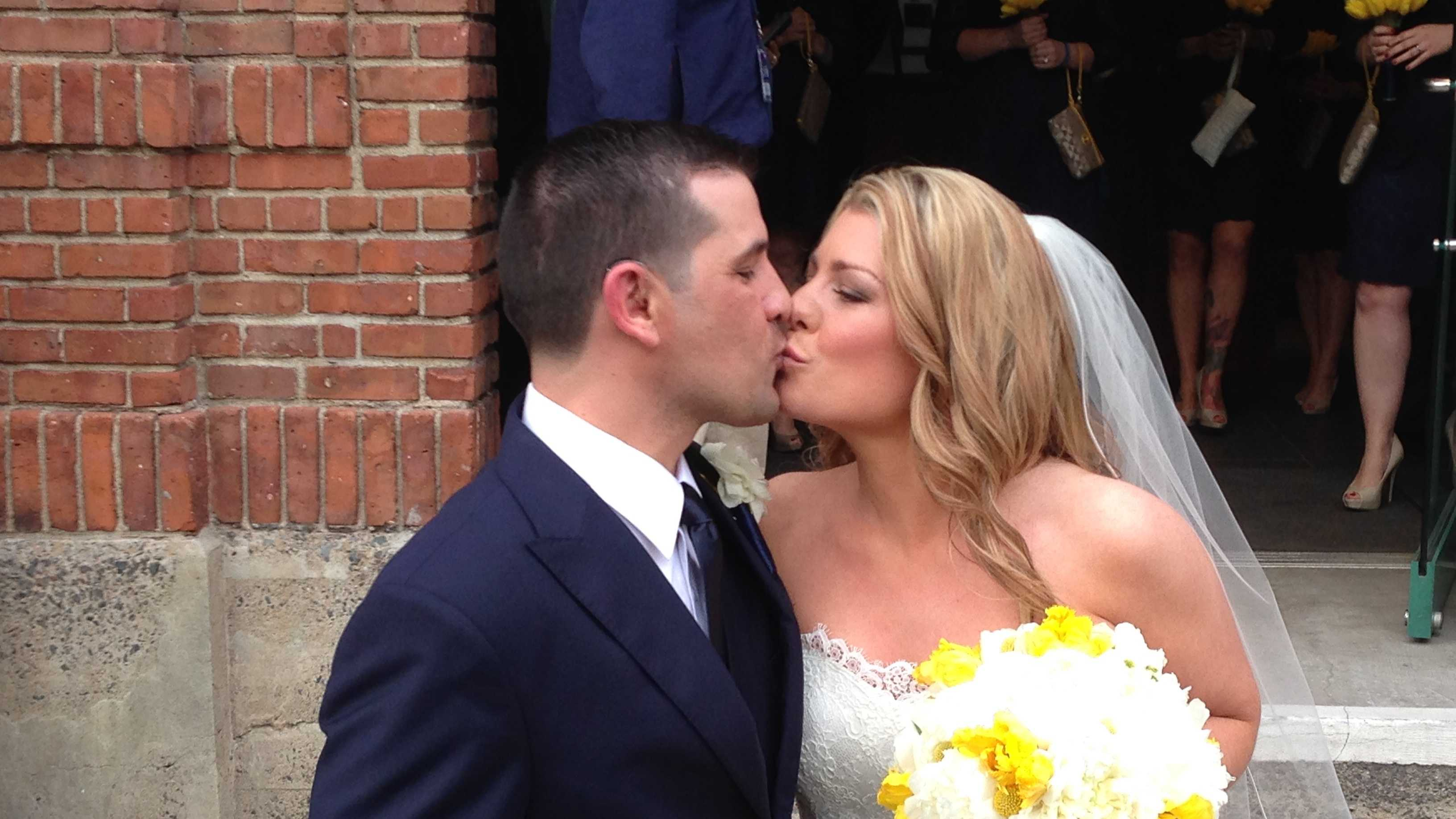 The pair has been engaged for 7 years. They pose outside Fenway Park for a kiss.
