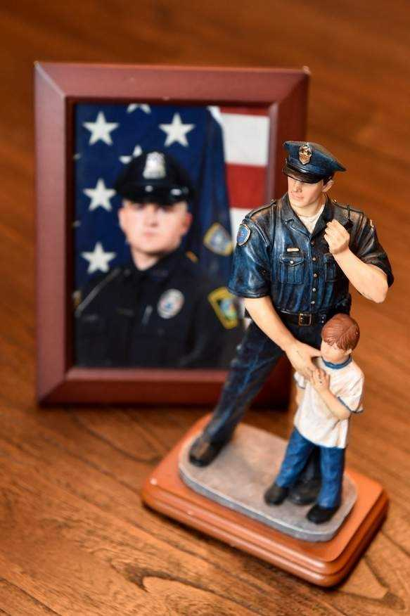 A framed photo of the late Sean Collier, along with one of his policeman statue figurines, are displayed in the home of his sister, Jen Lemmerman. She is also the Ward 2 alderman in Melrose. Wicked Local Staff Photo / David Sokol