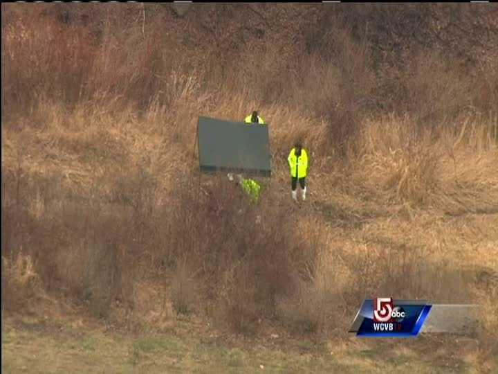 A tent was setup in the field, with investigators standing watch.