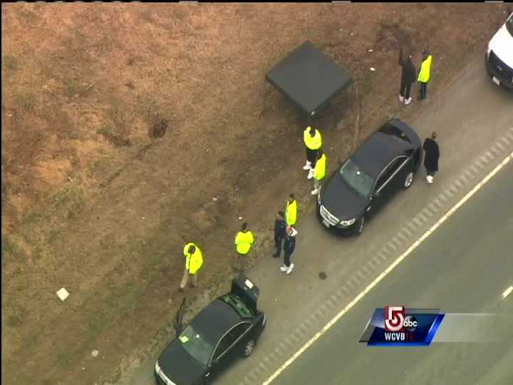 Sky 5 showed investigators walking in the brush and woods near the road.