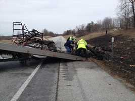Crews load the burned out wreckage onto a flatbed.