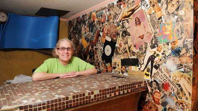 Patty Tripp of West Bridgewater stands next to the iconic mural in the basement of her home.