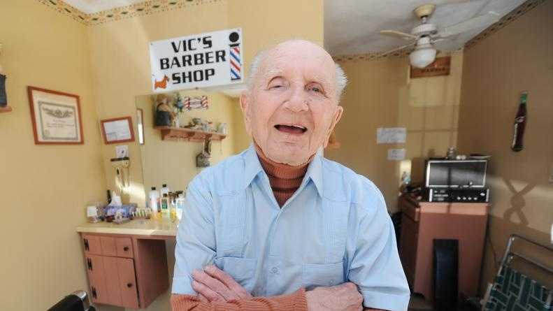 Victor Waryas, 95, charged 35 cents when he started cutting hair in the 1930s, seen here in his South Deerfield Barber Shop on Eastern Avenue next to his home.