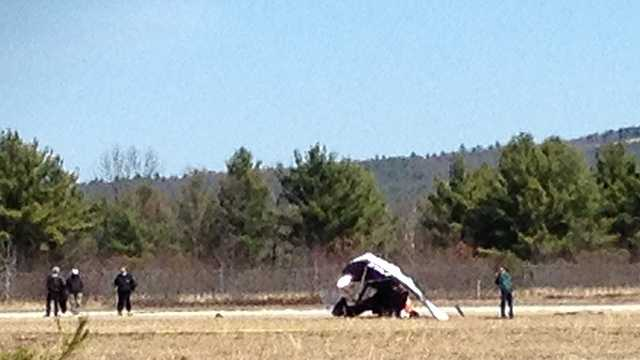 Plane flips on runway in Concord