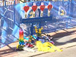 A shrine of crosses, Boston Strong ribbons and yellow daffodils popped up on Boylston Street to remember the victims of last year's marathon.