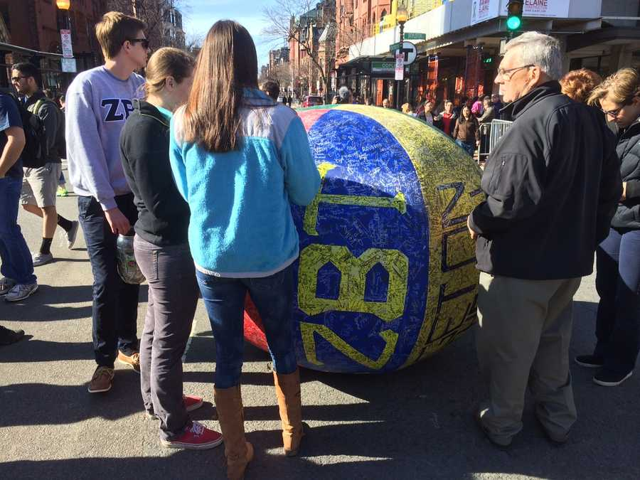 People were asked to sign a giant ball at the corner of Boylston Street, with donations for each signature going to Children's Hospital.