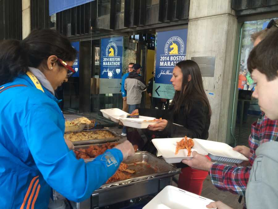 Runners gathered at Boston City Hall on Sunday night to gorge on pasta before the race.