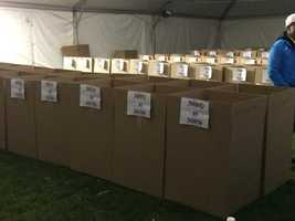 Rows of boxes await runners to check their bags.