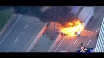 A car and a tractor-trailer were involved in a crash at about 5:30 a.m. in a northbound lane, and the truck caught fire.