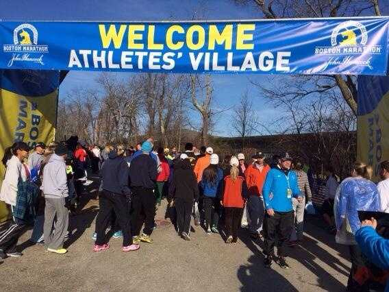 Runners begin to arrive in Hopkinton for the start of the 2014 Boston Marathon.