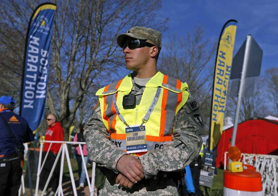 A military policeman stands near the start line of the 118th Boston Marathon Monday, April 21, 2014 in Hopkinton, Mass.