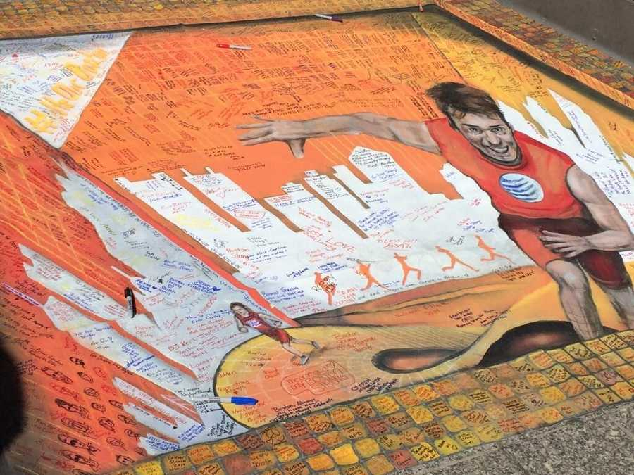 Street art on Boylston sidewalk messages of support 4 city and marathon runners.