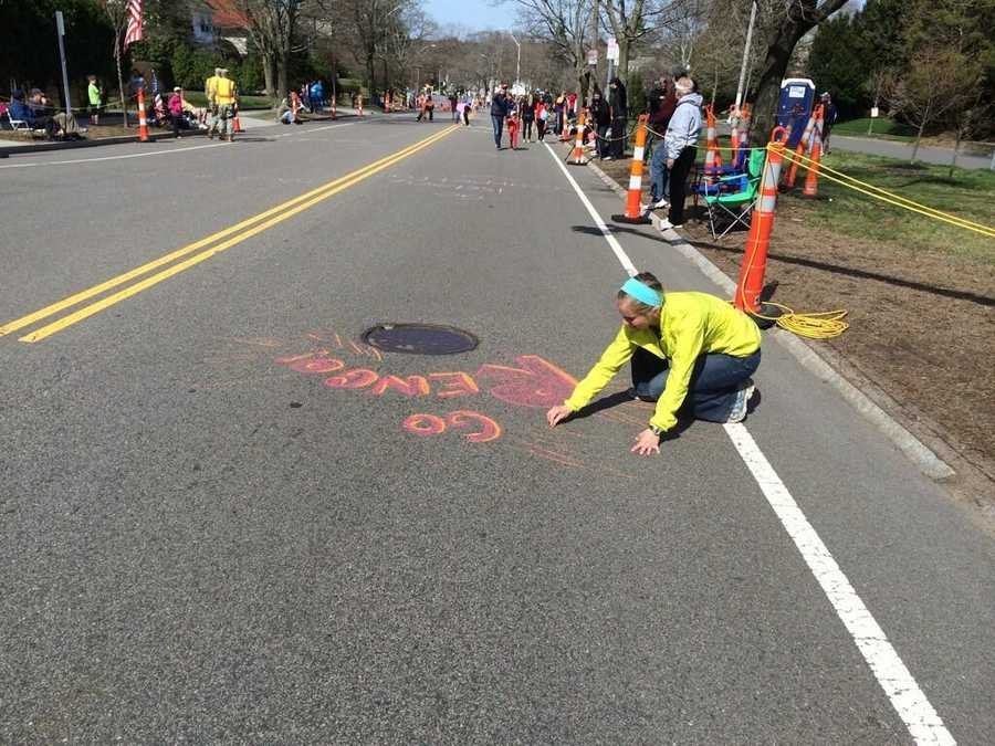 Jenna Rengo of Wisconsin leaving a message for her husband at the top of Heartbreak Hill.