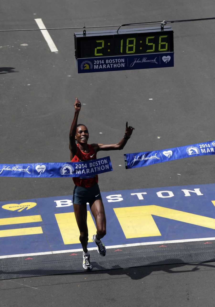 Rita Jeptoo, of Kenya, breaks the tape to win the women's division of the 118th Boston Marathon.