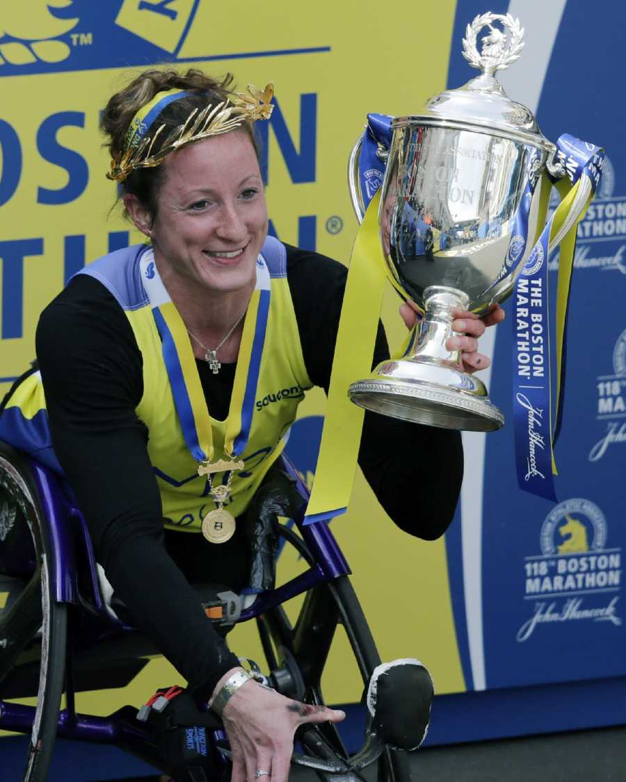 Tatyana McFadden, of the United States, receives her medal after winning the women's wheelchair division of the 118th Boston Marathon.