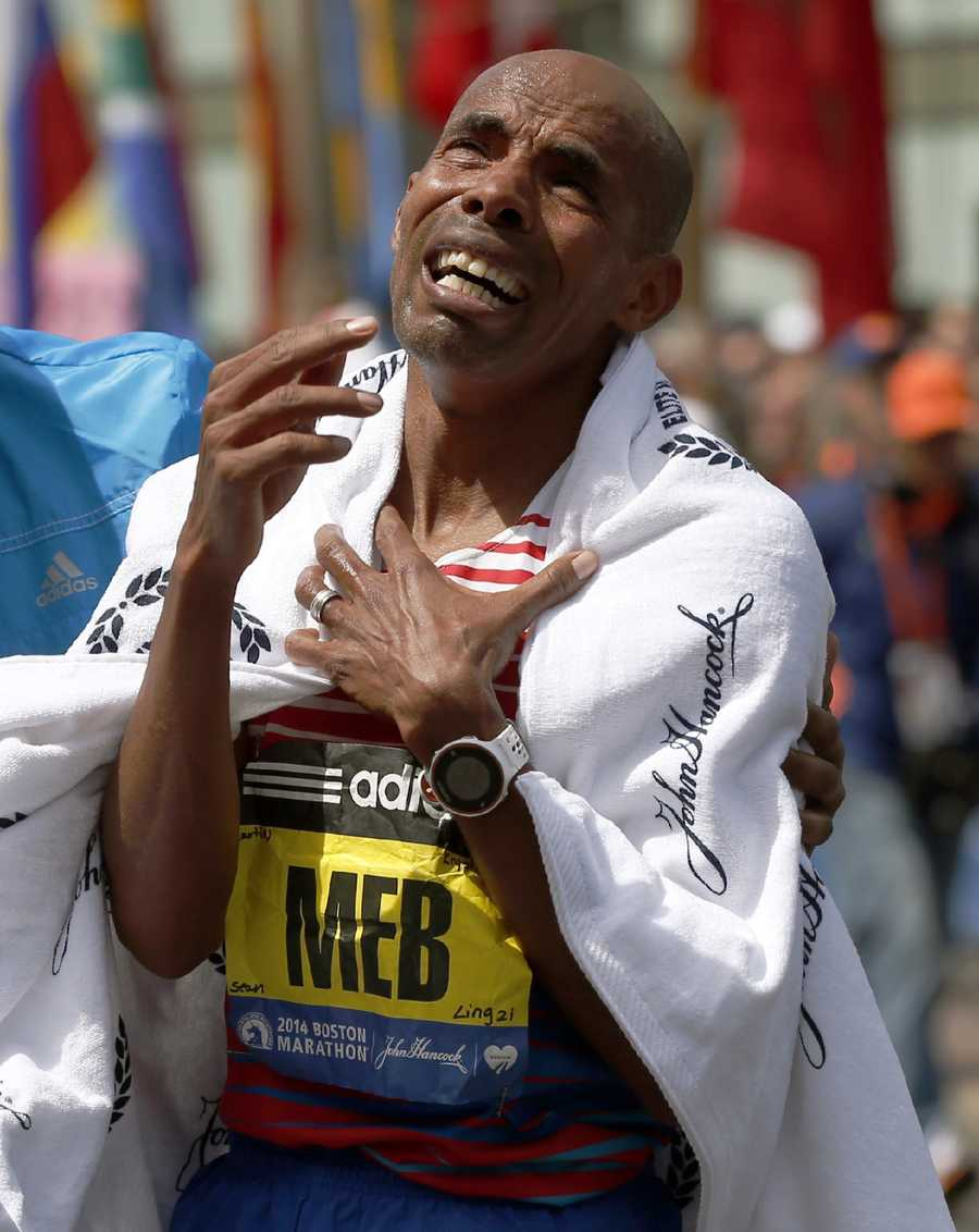 Meb's marathon bib has the names of the four victims killed during last year's marathon blast and manhunt for the bombing suspects.