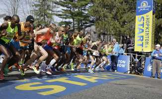 Elite men runners leave the start line in the 118th running of the Boston Marathon Monday, April 21, 2014, in Hopkinton, Mass.