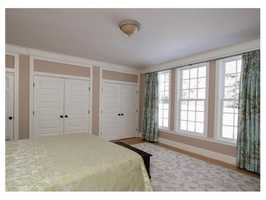 The second level has three bedrooms and includes an unfinished potential second floor Master suite