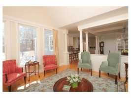 The open floor plan is light with large, well apportioned rooms and custom built-ins