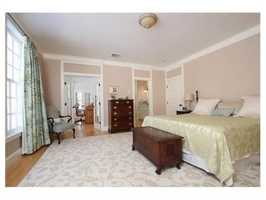 The en suite Master bedroom has ample closets and built-ins.