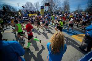 The first wave of marathoners begin to run at the starting line of the Boston Marathon in Hopkinton, Mass.
