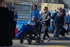 Dick Hoyt pushes his son, Rick at the starting line of the Boston Marathon before it begins in Hopkinton, Mass. Team Hoyt, as they are known, are running in their last Boston Marathon after more than 30 years.