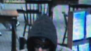 "Robbery - Case No. 140223April 18, 2014Lynn : Eastern Bank 112 Market StCase Details:On 4/18/14, 1513 hrs., Eastern Bank, 112 Market St., Lynn was robbed by the suspect in the attached photos. No weapon shown. A note was passed. The suspect may have waved down a passing vehicle when fleeing. Suspect described as a white male in his 30's, 5'11""-6'2"" tall, with a thin build. Suspect was wearing jeans, sneakers, a ¾ length gray Carhartt style jacket, a dark hoody, sunglasses, and a dark knit hat possibly with a Patriots logo.If you have any information about the identity of this person or where they are, please contact:Lynn Police Department: (781) 595-2000 x 4321Investigator: Det. Tom MulveyCase Submission No.: 140223"