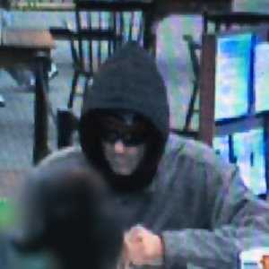 """Robbery - Case No. 140223April 18, 2014Lynn : Eastern Bank 112 Market StCase Details:On 4/18/14, 1513 hrs., Eastern Bank, 112 Market St., Lynn was robbed by the suspect in the attached photos. No weapon shown. A note was passed. The suspect may have waved down a passing vehicle when fleeing. Suspect described as a white male in his 30's, 5'11""""-6'2"""" tall, with a thin build. Suspect was wearing jeans, sneakers, a ¾ length gray Carhartt style jacket, a dark hoody, sunglasses, and a dark knit hat possibly with a Patriots logo.If you have any information about the identity of this person or where they are, please contact:Lynn Police Department: (781) 595-2000 x 4321Investigator: Det. Tom MulveyCase Submission No.: 140223"""