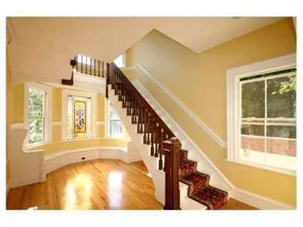 """The gracious foyer leads to a formal living room, """"music room"""", or sitting room, and paneled dining room with newly created access to the large brick patio"""