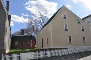 The Gedney House on the right and the Cox House on the left are on High Street in Salem. The earliest part of the Gedney House was built circa 1665.