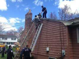 A man was rescued after falling from a ladder and becoming entangled in a power line in Milford Monday.