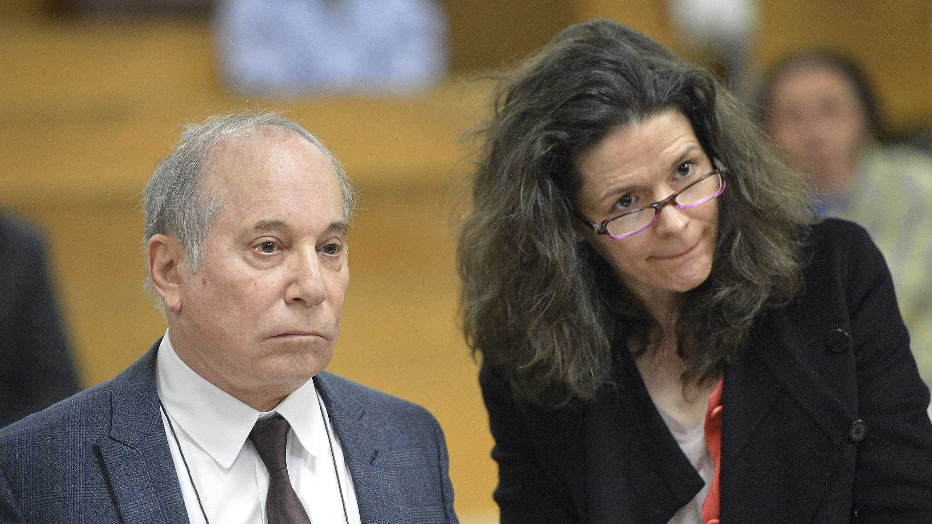 Singer Paul Simon, left, and his wife Edie Brickell appear at a hearing in Norwalk Superior Court on Monday April 28, 2014 in Norwalk, Conn.