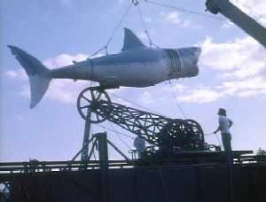 A mechanical shark attached to a tower.