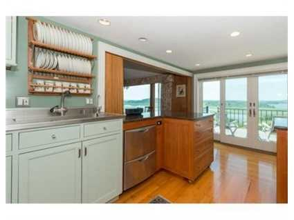 Many distinct and elegant features include a stunning custom granite, stainless kitchen.