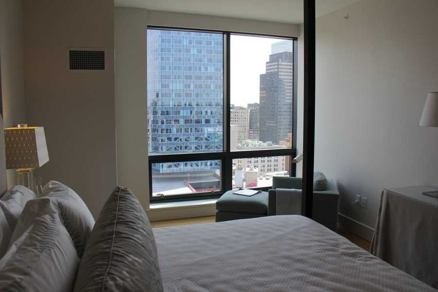 The two bedroom, two bath apartment features floor-to-ceiling windows.