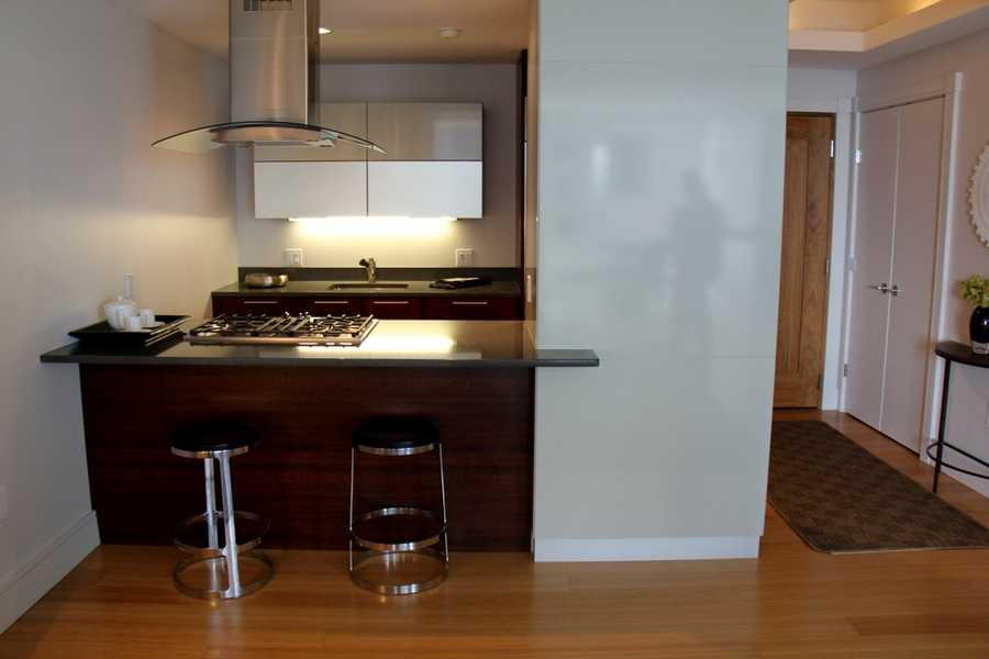 The modern kitchen area opens up to the living room.