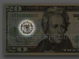 Federal Reserve Seal - A black seal to the left of the portrait represents the Federal Reserve System. A small letter and number beneath the left serial number identifies the distributing Federal Reserve Bank.