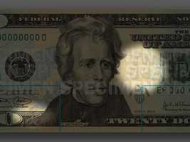 """Microprinting - Look very closely to see the small printed text """"USA20"""" along the border of the first three letters of the blue Twenty USA graphic to the right of the portrait.In the black border below the U.S. Treasurer's signature, look for the words THE UNITED STATES OF AMERICA 20 USA 20."""