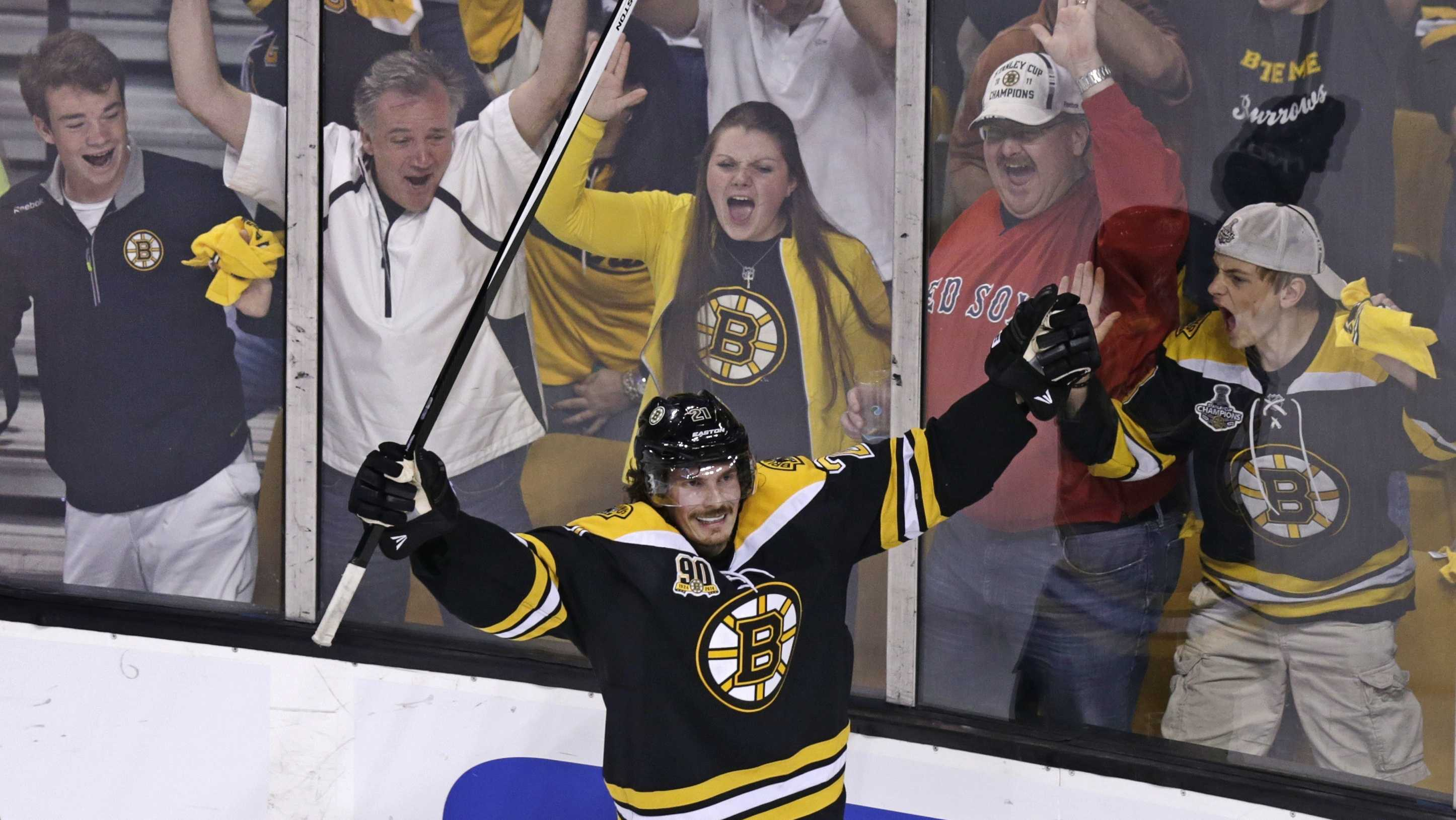 Boston Bruins left wing Loui Eriksson (21) celebrates his goal against Montreal Canadiens goalie Carey Price during the third period of Game 5 in the second-round of the Stanley Cup hockey playoff series in Boston, Saturday, May 10, 2014.