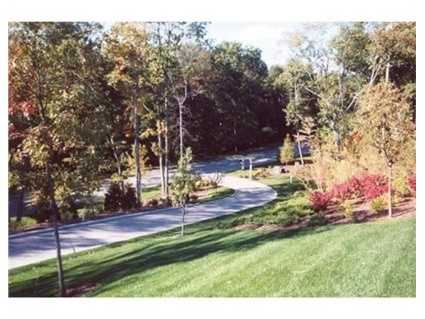 This magnificent stone and shingle colonial was completed in 2001 and is set on a beautiful 4 acre lot.