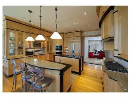 Asuperb kitchen with butler's pantry and charming eating area.