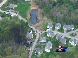 """Investigators searching through the debris for any clues. """"To say it was completely devastated is an understatement."""""""