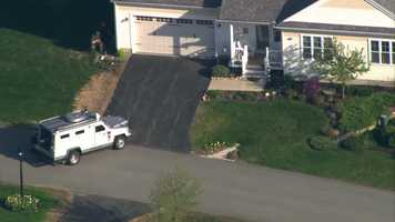 5:19 p.m. - Seacoast emergency response and New Hampshire State Police SWAT team remove Walter Nolan from the scene. He was found cuffed in the front yard.