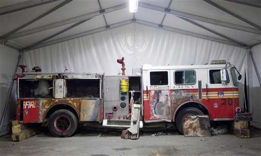A damaged New York Fire Department truck is part of the collection of artifacts.