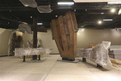 The 'Cross' -- intersecting steel beams found in the rubble of 6 World Trade Center and a fragment of a trident column.