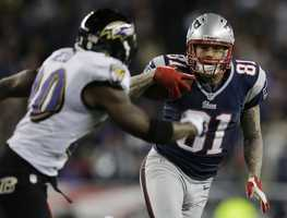 New England Patriots tight end Aaron Hernandez (81) is chased by Baltimore Ravens free safety Ed Reed during the first half of the NFL football AFC Championship football game in Foxborough, Mass., Sunday, Jan. 20, 2013. (AP Photo/Matt Slocum)
